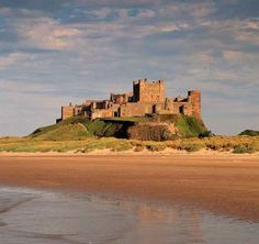 Bamburgh Castle,  Bamburgh, Northumberland, England....    http://www.castlesandmanorhouses.com   ....     The location was previously the site of a fort of the native Britons known as Din Guarie from its foundation in c.420.  The Normans built a new castle on the site, which forms the core of the present one.  It has featured in films such as Ivanhoe (1952), El Cid (1961), Mary, Queen of Scots (1971), and Elizabeth (1998). It is a Grade I listed building.