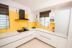 7 Tips for Vastu Colours for Kitchens in Indian Homes Best Kitchen Colors, Colorful Kitchen Decor, Kitchen Colour Schemes, Kitchen Paint Colors, Kitchen Room Design, Kitchen Interior, Contemporary Kitchen Paint, Layout Design, Orange Kitchen Designs