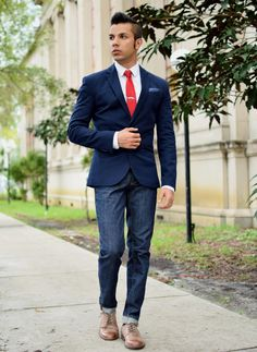Go for a white dress shirt and navy jeans to create a smart casual look. Channel your inner Ryan Gosling and opt for walnut leather derby shoes to class up your look.  Shop this look for $212:  http://lookastic.com/men/looks/jeans-and-dress-shirt-and-blazer-and-pocket-square-and-tie-and-derby-shoes/3907  — Navy Jeans  — White Dress Shirt  — Navy Blazer  — Navy Polka Dot Pocket Square  — Red Tie  — Walnut Leather Derby Shoes