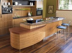 Japanese kitchen with natural wood flooring and furniture