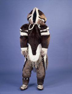 Woman's outer parka made of caribou skin, and accessories. Canada, Nunavut, Baffin Island, Igloolik Island.