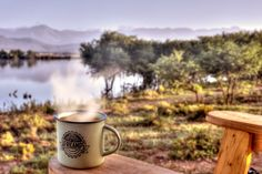 AfriCamps Glamping at Klein Karoo, South Africa. There is no better way to enjoy that morning cup of coffee.