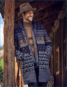 Jan Trojan charms in a fedora Albertus Swanepoel, knit coat, turtleneck sweater…
