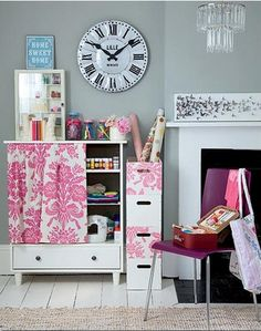 organized craft area - I like the idea of fabric in front of the shelves to hide the clutter.