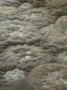 Love the lace, buttons and soft grey (I'm seeing it in pink, of course, for a shabby chic or cottage style room!)