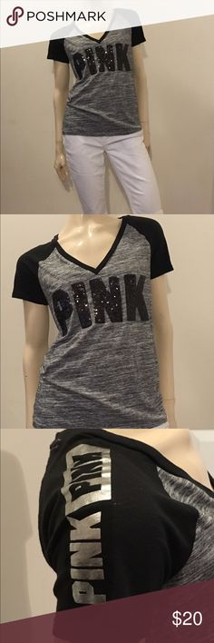 Size medium Pink Victoria's Secret t-shirt Cute grey and black size medium Pink Victoria's Secret t-shirt, all sequins intact, cute silver pink details on top of the shoulders, great condition and gently used. PINK Victoria's Secret Tops