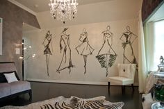 A wall of model sketches brings the room to life on Donna Decorates Dallas.