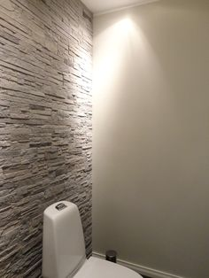 Toilet walls for customer. The other wall is made by Tunto hieno it is like sand feeling