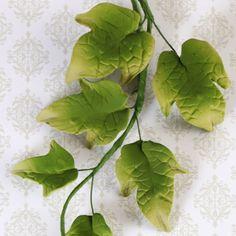 Green Ivy Leaf Filler Spray handmade gumpaste cake decoration perfect for fondant wedding cakes and birthday cakes. | www.CaljavaOnline.com #caljava #gumpaste #cakedecorating #cake #sugarflower