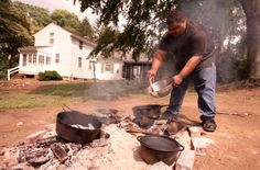 Culinary historian Michael Twitty prepares food at the plantation site where Josiah Henson, who inspired the title character in Uncle Tom's ...