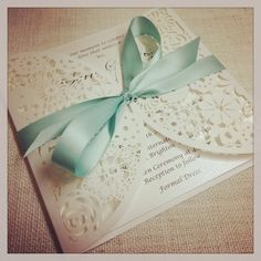 This is a listing for one SAMPLE Mint Floral Paper Lace wedding invitation - the invitation has a lovely floral paper lace laser cut outer