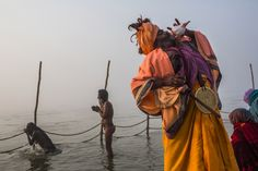 Jan. 13, 2013. A Sadhu blows a conch shell as holy men bathe on the banks of the Ganges river during a procession ahead of the Maha Kumbh Mela in Allahabad, India.
