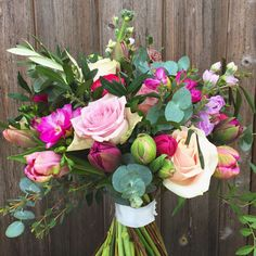 Pink Spring bridal bouquet at Farnham Castle-flowers created by Eden Blooms Florist from Pink Ranunculus, Memory Lane Rose, Sweet Avalanche Rose, Pink Freesia, Pink Tulip, Parrot Tulip, Pink Astrantia, Purple Stock & Eucalyptus.