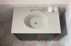 Clean bathroom counter featuring Kohler Solid/Expressions