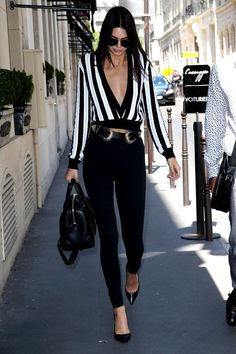 Kendall Jenner, a denim devotee, has discovered a way to keep things interesting and that thing is a serious statement belt. Whether you're a tassel girl, or up for Kendall's '90s throwback, all eyes are on the waist.B-low belt, $158, freepeople.com.
