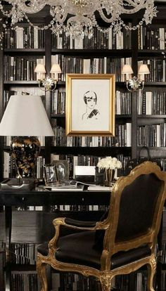 I love the feel of this little library/office. The dark & heavy furniture makes the room have a masculine feel, but there are lots of feminine touches in the accessories (especially the chandelier).