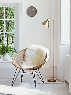 Inspired by classic 1950's design, our stylish flat rattan occasional chair has a strong black iron frame and blonde rattan finish.