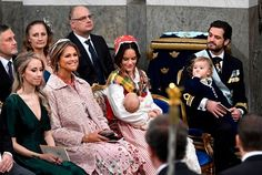 (L-R) Sara Hellqvist (sister of Princess Sofia), Princess Madeleine of Sweden , doting Princess Sofia wore traditional Swedish folk costume for the event holding baby Prince Gabriel and Prince Carl Philip wore ceremonial dress,while caring for their eldest son Prince Alexander sit during prince Gabriel's christening in Drottningholm Palace Chapel outside Stockholm, on December 1, 2017.