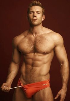 All about the redheads. Hot ginger man in briefs. Male model with muscles in men's swimwear.
