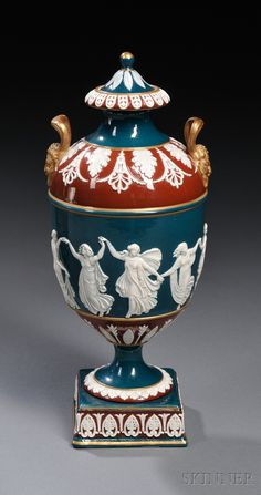 Wedgwood Victoria Ware Vase and Cover, England, c. 1880, gilt trim lines and Bacchus mask handles, applied classical Dancing Hours in relief bordered with a variety of foliate designs