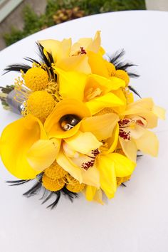 yellow bridal bouquet black feathers yellow gray black calla lily orchid billy ball protea durmstick studio stems