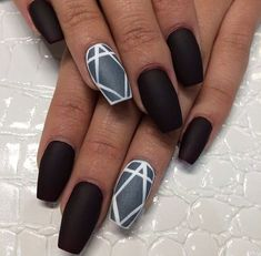We think these black matte nails with grey geometric print on the third finger are very cool...x