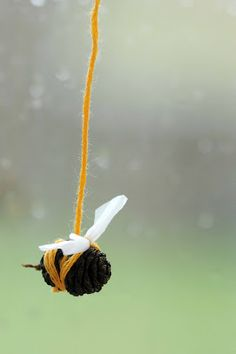bee made from alder tree cone nature craft