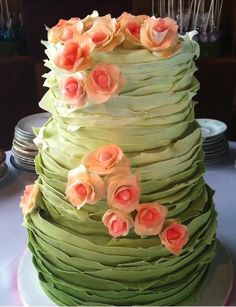 Green ombre ruffle wedding cake with pink roses.. Where was this for my wedding!!!!