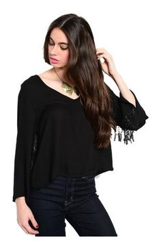 Juniors Sizing 100% RAYON CHINA This chic and trendy long sleeve blouse features a scoop neckline, cropped design, relaxed fit, and fring trimmed flared bell shaped sleeves. Dress up for a night out this season in our Cropped Blouse W/ Fringe Trimmed Bell Sleeves. This chic and trendy long sleeve blouse features a scoop neckline, cropped design, relaxed fit, and fring trimmed flared bell shaped sleeves. Complete the look with black skinnys, a long layered necklace, and high heels.