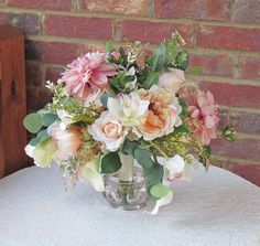 This item is an example only! This was a custom bouquet that was previously made if you need something similar, please contact me so we can come up with something special just for you!! DO NOT PURCHASE THIS LISTING!!!  This bouquet was made to WOW, lots of beautiful lush flowers and greenery. Soft peach colored open roses mixed in with light pink dahlias. Filled in with more roses, seeded eucalyptus, berries, and gold springs of greenery. For an added formal touch I placed in a few callas…
