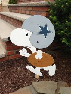 "Snoopy football lawn ornament with lawn stake any by MAJdesign, $35.00  wonder if she can make this to say ""Tackle Breast Cancer"" on the helmet?"