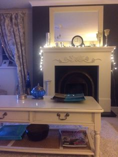 Cosy fireplace. Cream surround and wall painted in Dulux Bowler hat