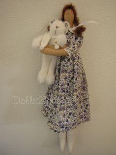 Tilda doll Stephanie wearing a liberty fabric dress by Dolls2love
