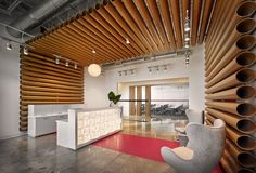 Interior Design Magazine: Florida HQ by welcomes visitors with fabric tubes, foreshadowing . Corporate Office Design, Corporate Interiors, Office Interiors, Hotel Reception Desk, Reception Desk Design, Interior Design Companies, Office Interior Design, Interior Decorating, Office Designs