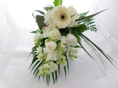 Trailing wedding bouquet in whites and greens, white roses, white gerberas, white snapdragons. Created by Florist ilene, Hamilton, NZ Flowers Delivered, White Roses, Gift Baskets, Hamilton, Wedding Bouquets, Beautiful Flowers, Wreaths, Table Decorations, Gifts
