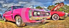 Custom painted pink with black stripe 1970s Chrysler Dodge R/T on display at car show held in Melbourne, Australia.