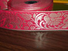 Beautiful Hot Pink Color Jacquard ribbon border trim with Elephant Pattern. Trim is decorated with silver color metallic thread embroidery.   This stunning lace can be used for designing stylish...