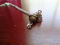 Peter Pan thimble and acorn necklace by TinkerGirlBoutique on Etsy
