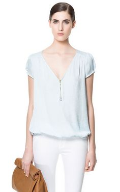 Image 1 of BLOUSE WITH ZIP NECKLINE from Zara