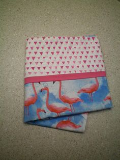 Great gift for all ages - toddler to elderly. Christmas stocking stuffer, birthday, other holiday or just because! Use for travel, summer camp, hunting/fishing camp, travel trailer, watching TV, sleepovers or just for fun! Standard/Queen size pillow case features pink flamingos on a blue