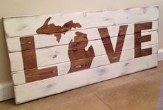 This is a handmade wood wall art sign with the word LOVE. Here the o is substituted with the state of Michigan image. This sign measures