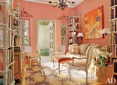 The library is no stranger to attention and is filled with fascinating furnishings, antique finds, and color combinations. The peachy pastel-hued walls give ...