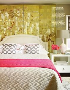 The room divider acts as artwork behind the bed... nice layering affect. Betsy Burnham