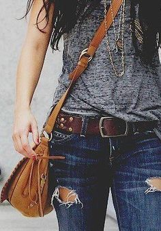 Like this combo of slouchy dark grey / lead colored tee with a thick brown belt on dark wash lightly destroyed jeans. And of course you can't forget the pendant to pull it all together