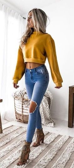 #fall #outfits women's brown crop sweatshirt and distressed blue fitted jeans outfit