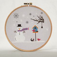 Winter Cross Stitch Pattern with snowman, snowflakes and birdhouse by BisforBumblebee