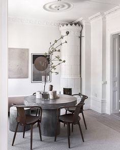 I think a move to Stockholm is in order, how about you?! See the full tour on the blog today! For sale through @alexanderwhitesthlm photo @kronfoto styling @annaleena.interiors #diningroom #kakelugn #swedishfireplace #concretetable
