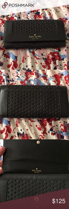 """Kate Spade Mercer Isle Cindy wallet Description: Long wallet  Leather Cut-out details Back slip pockets. Two slip pockets, a zip divider pocket, and six card slots Flap opening with snap closure Measurements: Body length 7½"""", height 3¾"""", width 1½""""  Material: Leather  Brand: kate spade New York kate spade Bags Wallets"""