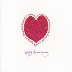 Red satin embroidered heart on rich red fabric on a bed of gold twinkles. #RedHeart #AnniversaryCard #HandmadeCard
