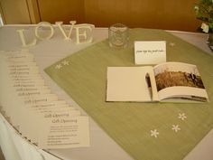 Green guest book table